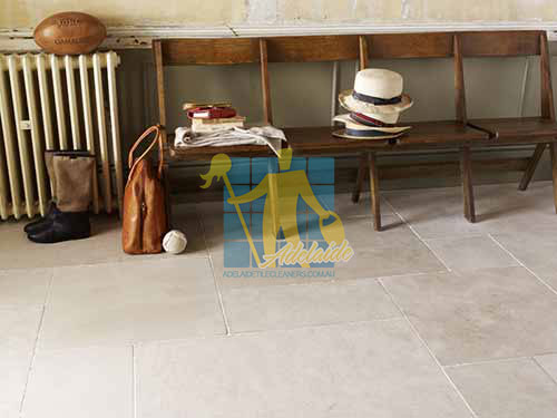 Adelaide limestone tile sample storm tumbled white grout wooden chair