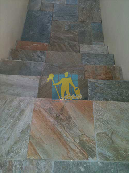 close_shot_of_clean_slate_tiles_unsealed_after_stripping_and_cleaning_outdoor_entry_stairs_before_sealing