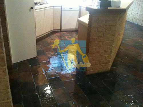 shiny slate tiles in kitchen sealed_with glossy topical sealer very wet look