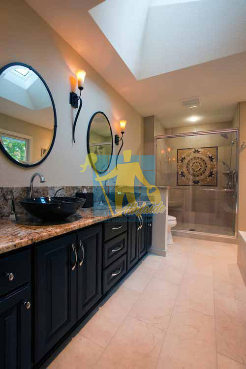 contemporary bathroom with marble tile floors and wooden cabinet and shower