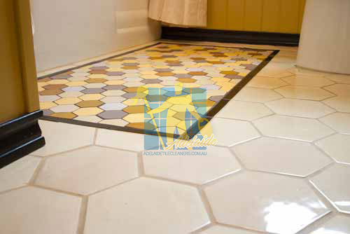 eclectic bathroom with white ceramic tile floors with honeycomb like design after cleaning Adelaide