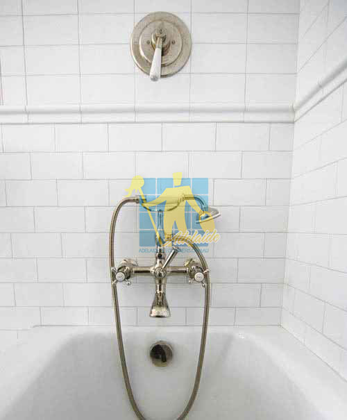 traditional bathroom with white ceramic tiles on wall small size grey grout lines