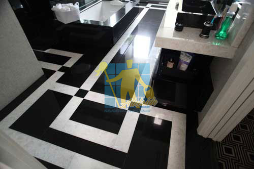 absolute black granite slab floor with white quartzite bands