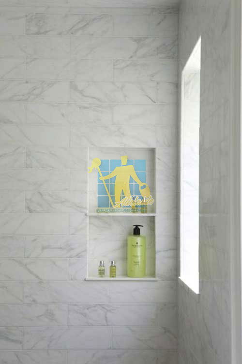 Playford marble tiled shower with window
