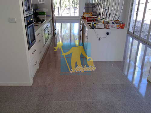 terrazzo tiles indoors large room large windows shadow during cleaning